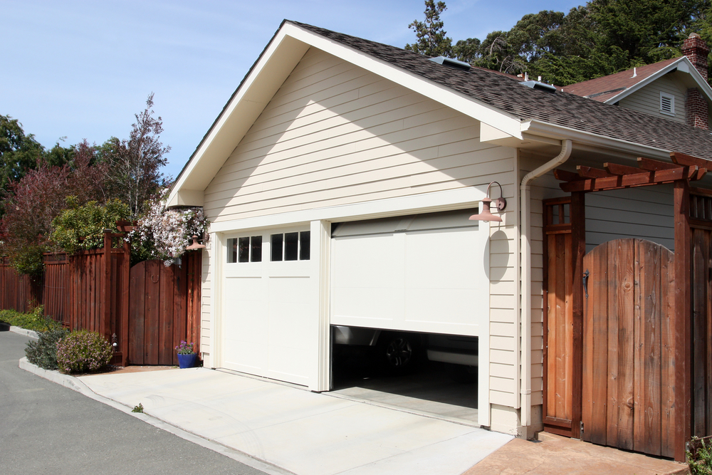 Automatic Garage Door Opener opening a home's garage mid-afternoon